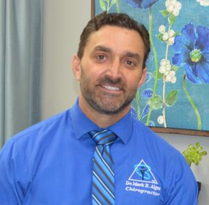 Dr. Mark Algee in his office at Ventura Chiropractic